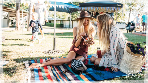 Young women having a picnic at the Village Markets, Burleigh Heads