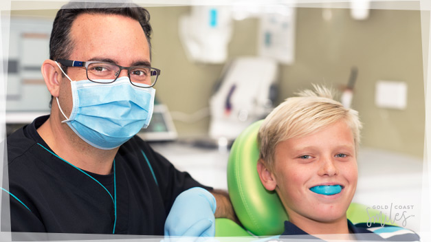 Dr. Nick and child patient with blue mouth guard